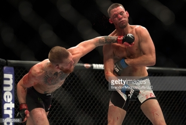 513972668-conor-mcgregor-punches-nate-diaz-in-their-gettyimages